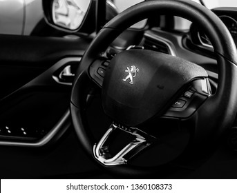 Brasília, Federal Distric - Brazil. April, 04, 2019. Photograph of the interior of a car Peugeot 208 Griffe 1.6 Automatic model 2014. Highlight the steering wheel with the logo.