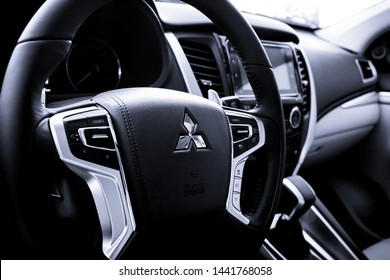 Brasília, Federal District - Brazil. July, 02, 2019. photo of the interior of a Mitsubishi Pajero Sport 2019 vehicle. Highlight the steering wheel of the car with the company logo.