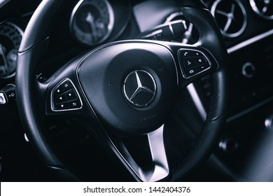 Brasília, Federal District - Brazil. July 4, 2019. Photograph of the interior of a vehicle Mercedes-Benz GLA 200 2016. Highlight the photo for the steering wheel with the company logo.