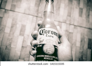 Brasília, Federal District - Brazil. June, 03, 2019. Close-up photograph of a man holding a bottle of Corona beer with his hand.