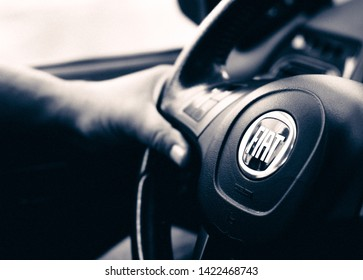 Brasília, Federal District - Brazil. June, 11, 2019. Man holding the steering wheel. Photo of the interior of a car Fiat Pálio Weekend 1.8 model 2016.