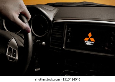 Brasília, Federal District - Brazil. September, Circa, 2019. Photograph of the interior of a Mitsubishi Lancer GT 2015 car. Logo of the Japanese company on the screen of the power station.