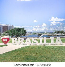 "Brasília, Federal District - Brazil. Traditional sign of the Brazilian capital with the writing ""I love Brasília"". It is located near the analog tv tower in front of the light source."