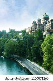 The Federal Palace government building in Bern, with the Aare River in the foreground