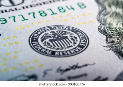 Federal reserve system symbol on hundred dollar bill closeup macro shot
