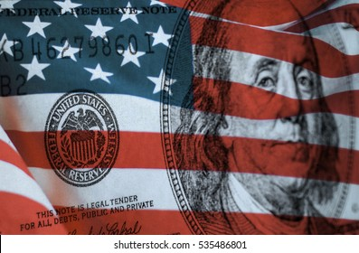 Federal reserve system symbol on hundred dollar bill with united states of america flag