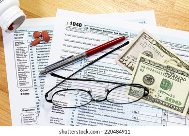 Federal tax forms with asprin and money