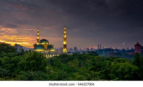 The Federal Territory Mosque or Masjid Wilayah Persekutuan, Kuala Lumpur Malaysia during sunrise.