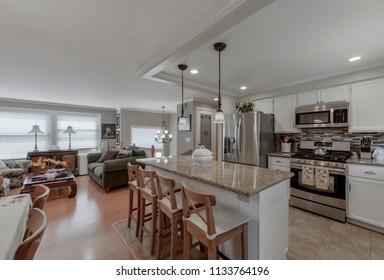Federal Way, WA / USA - July 11, 2018: Modern kitchen and living room interior
