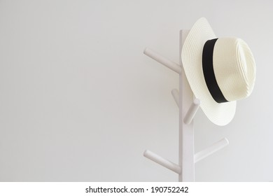 Fedora hat hanging on pole stand