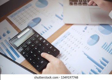 Fee and Tax concept, Male Business auditor using calculator in the cafe.