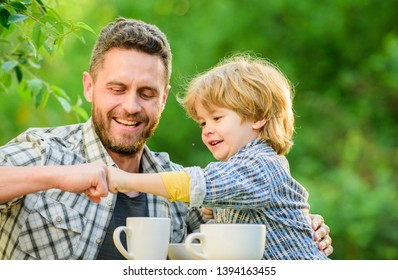 Feed baby. Natural nutrition concept. Fathers day. Best friends. Father and son having fun. Feeding son natural foods. Healthy food. Father and boy drink tea outdoors. Develop healthy eating habits.