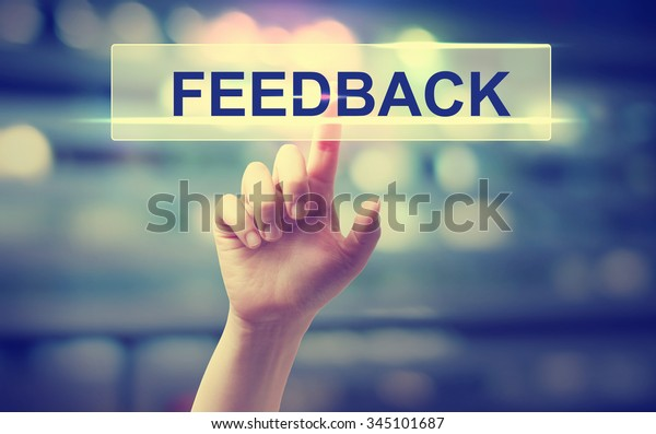 Feedback concept with hand pressing a button on blurred abstract background