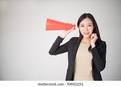 Feedback, Survey, Comment, Opinion concept background with asian woman hold red speaker cone. Customer feedback or comment and marketing survey is the part of business development.