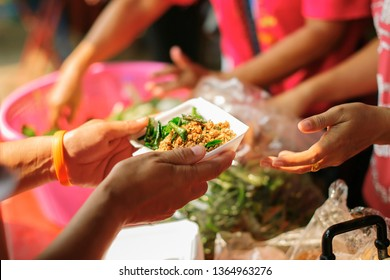 Feeding the hungry to get a taste for the poor Make humanitarian society : concept social contribution : Donate leftover food to hungry people