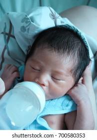 Feeding a newborn baby boy