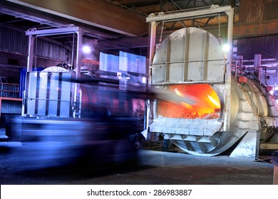 Feeding scrap aluminium in a melting oven in a factory. Recycling.
