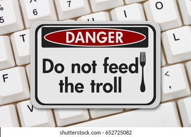 Feeding the troll danger sign, A black and white danger sign with text Do not feed the troll and fork icon on a keyboard 3D Illustration