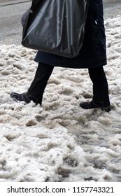 Feeds in wet snow on the street, dirty snow, walking through slush, vertical