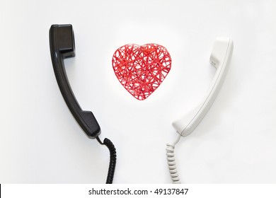 I feel the connection. Black and white phones with red heart.