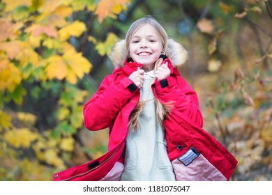 Feel so cozy in warm jacket. Child blonde long hair walking in warm jacket outdoor. Girl happy in coat enjoy fall nature park. Child wear fashionable coat with hood. Fall clothes and fashion concept.