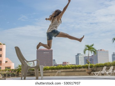 Feel good and freedom concept. happy woman jumping