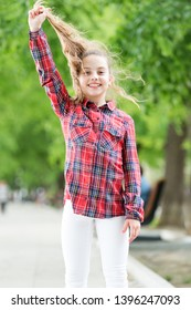 Feeling cozy and comfortable on windy day. Deal with long hair on windy day. Hairstyles to wear on windy days. Windproof hairstyles. Girl little cute child enjoy walk on windy day nature background.