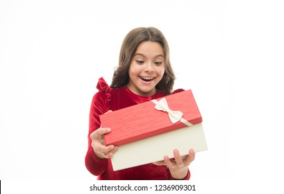 Feeling so excited. Kid little girl in elegant dress hold gift box white background. Child excited about unpacking her gift. Small cute girl received holiday gift. Best toys and christmas gifts.