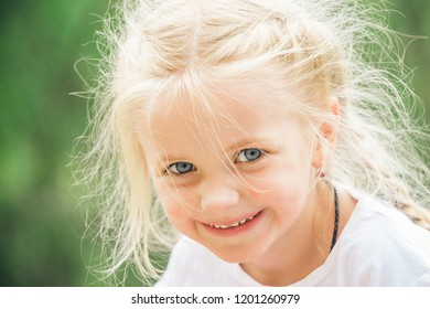 Feeling free and happy. Little girl wear hair in plaits. Small girl with blond hair. Happy little child with adorable smile. Small child happy smiling. I love changing my hair.