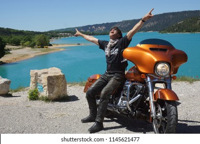 Feeling free and happy on a Harley-Davidson driving through the Gorges du Verdon, Gorges du Verdon, Provence/France - May 10 - 2014
