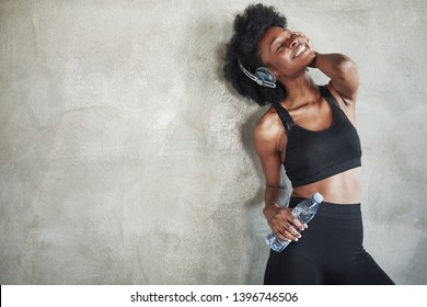 Feeling good. Portrait of african american girl in fitness clothes having a break after workout.