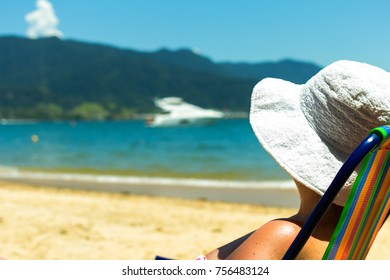 Feeling at home away from home - Brazilian woman at the beach - Ilhabela - Sao Paulo - Brazil