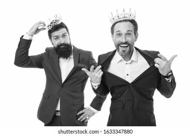 Feeling as king. Self esteem. Elite society. Elite services. VIP concept. Rich and powerful people. Bearded men. Elite community. Royal benefits club. Men wear crowns. Businessmen successful people.