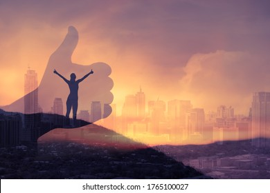 Feeling positive and happy. Motivated, inspired woman with thumbs up on a mountain top overlooking the city. double exposure