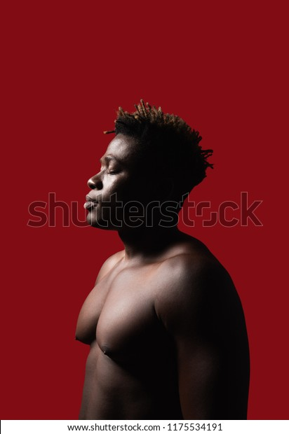 Feeling relaxed. Side view portrait of shirtless strong gentlemen with closed eyes