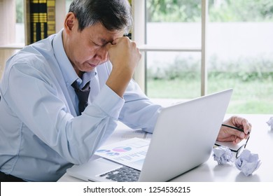 Feeling sick and tired, Senior businessman depressed and exhausted, businessman at his desk frustrated with problems and keeping eyes closed while sitting on office.