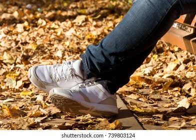 feet adult person in the yellow leaves. autumn.