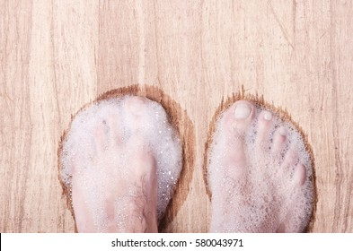 feet are bathed in soap