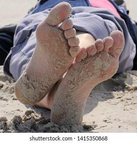 Feet with beach sand - Make break