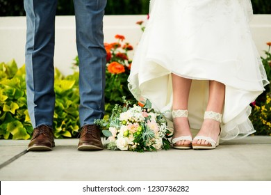 Feet of Bride and Groom with Bouquet