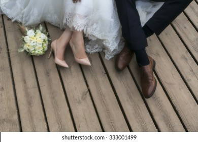 feet of bride and groom, wedding shoes (soft focus). Cross processed image for vintage look
