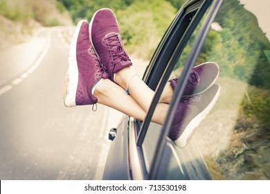 feet in the car window, concept of travel and vacation