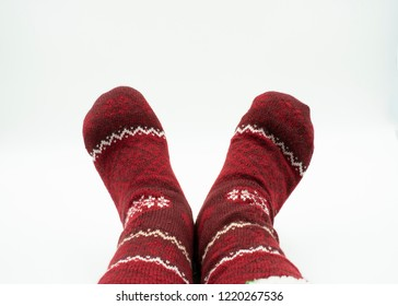 Feet with christmas socks isolated on white