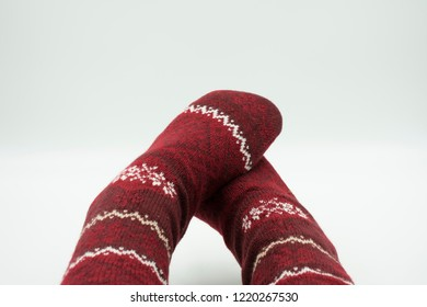 Feet in cozy Christmas socks isolated on white