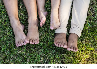 The feet of a different age three.