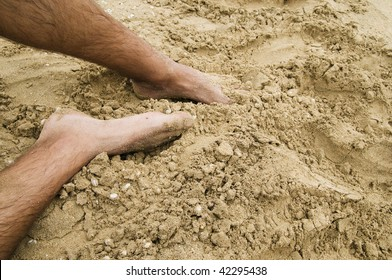 Feet digging in the sand