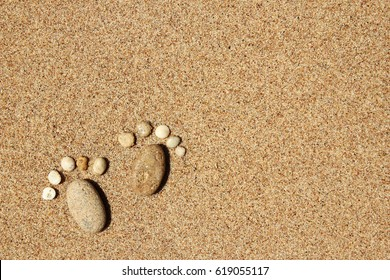 a Feet of a family of stones on the sea