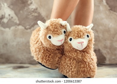 feet female wearing cute llama trendy slippers soft pastel colours beige