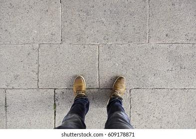 Feet floor, detail of walking boots