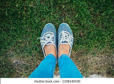 feet of the girl on the grass